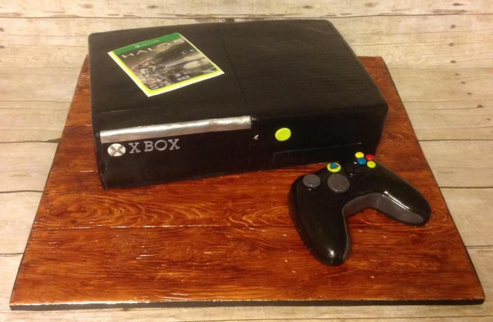 [Image: If you're a gamer then you will love this xbox 360 cake; complete with black frosting and a tasty controller! ]