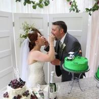 Bride & Groom with their Cakes