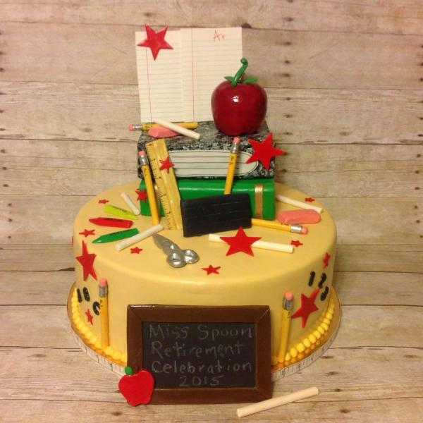 [Image: A great retirement cake for a teacher featuring school supplies.]