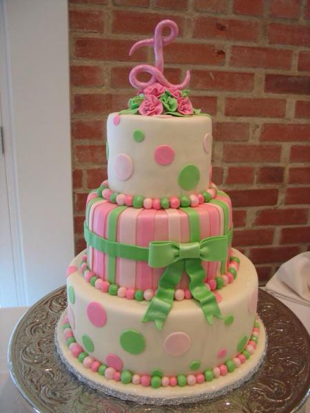 [Image: A pink and green wedding cake with polka dots and stripes.]
