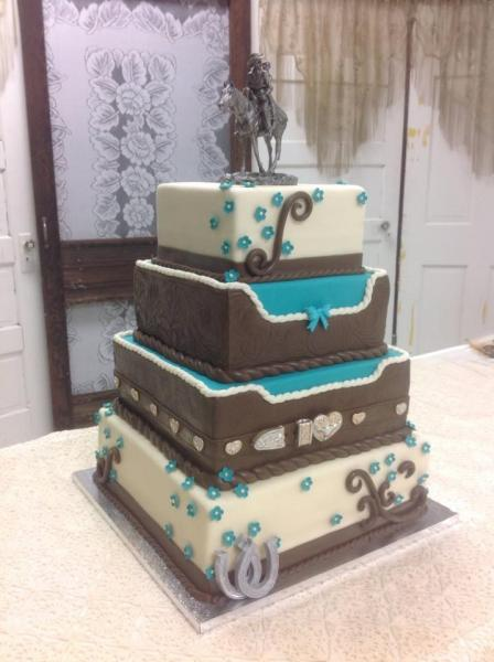 [Image: A unique cowboy themed wedding cake with a belt buckle and horseshoes.]